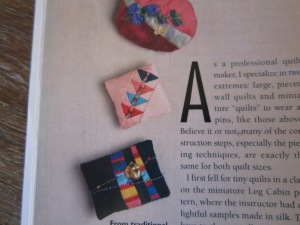 close up shot of brooches in magazine