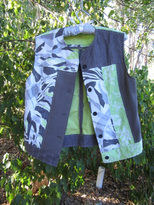 Green, white and grey scrappy vest
