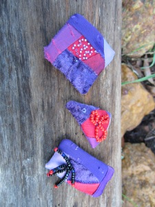 Patchwork brooches or pins, red & purple