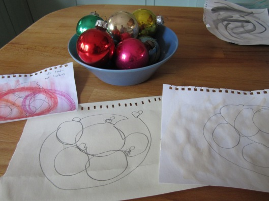 bowl of Christmas baubles and single line drawings