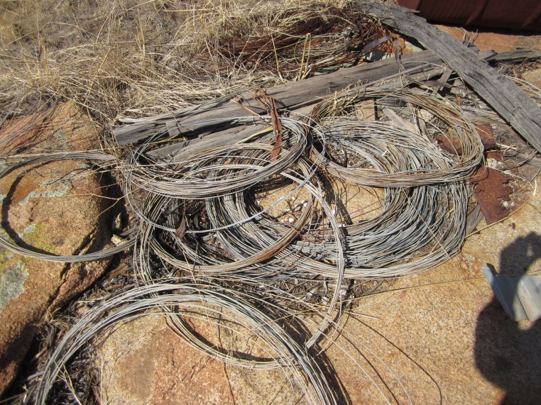 coils of old fence wire