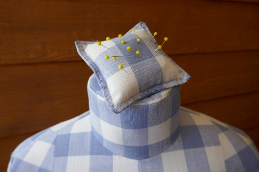 pincushion on top of dress form
